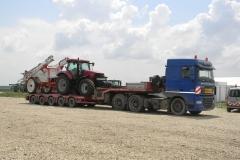 transport agabaritic tractor Case HI cisterna apa