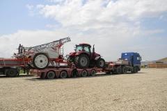transporturi utilaje tractor Case cu remorca de stropit Kuhn